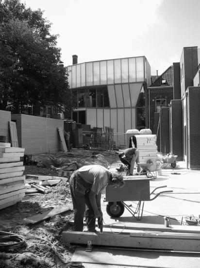 Black and white photo from construction site with worker in the shot.