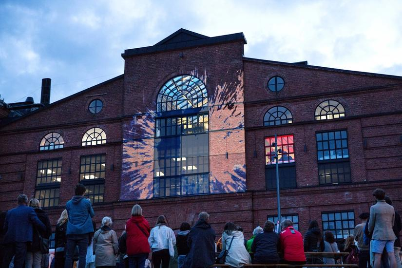 Visual art made with light on the sea side facade of verkstedhallen