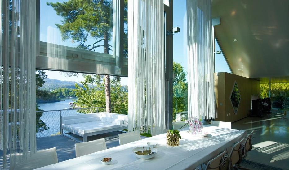 Interior shot where large glass windows opens up a beautiful view over the Oslo Fjord.