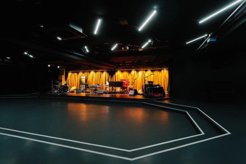 Photo of concert stage in the basement