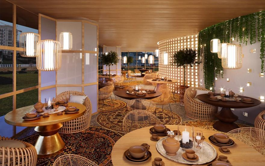 Interior shot with round tables, round carpets with dense pattern and plants.