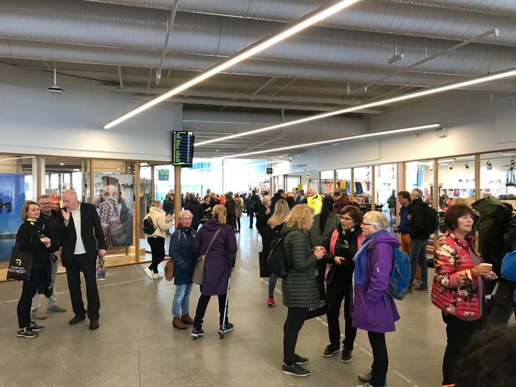 Photo of entrance hall filled with travelers
