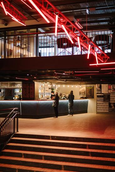 Photo bar area, neon art and part of the central staircase