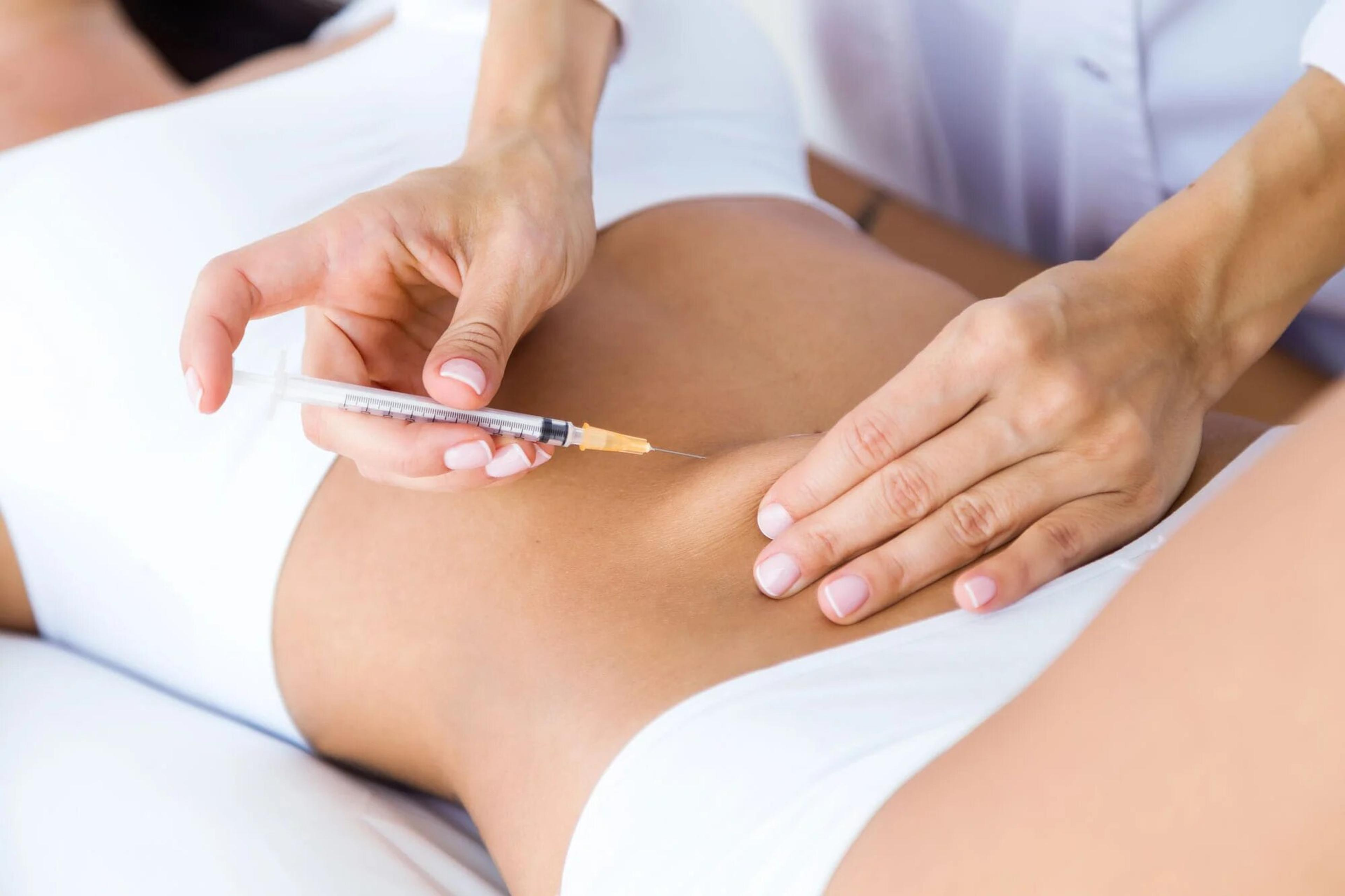 Patient receiving cosmetic injection in the abdomen