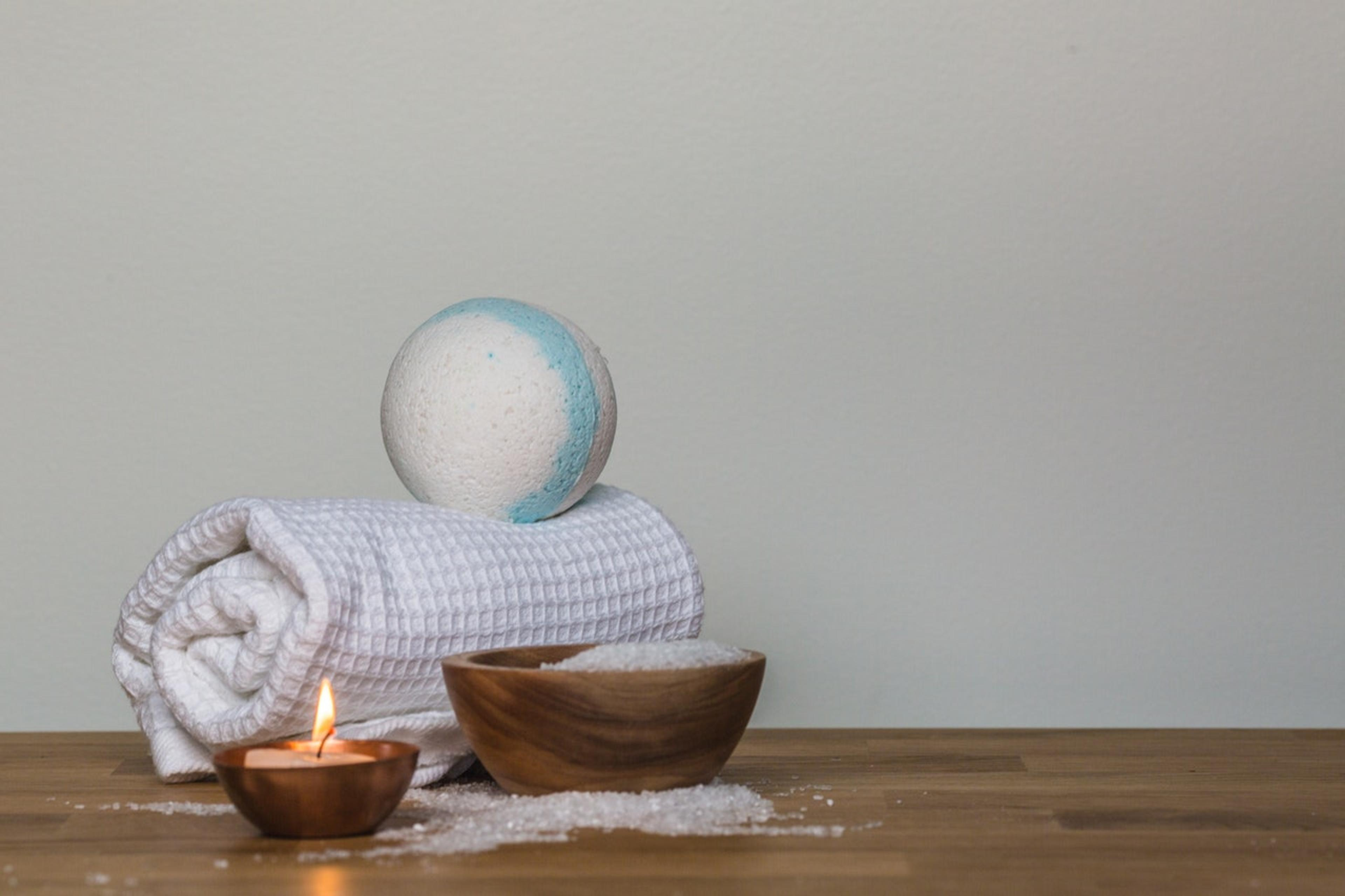 Spa towel, bath bomb and candle