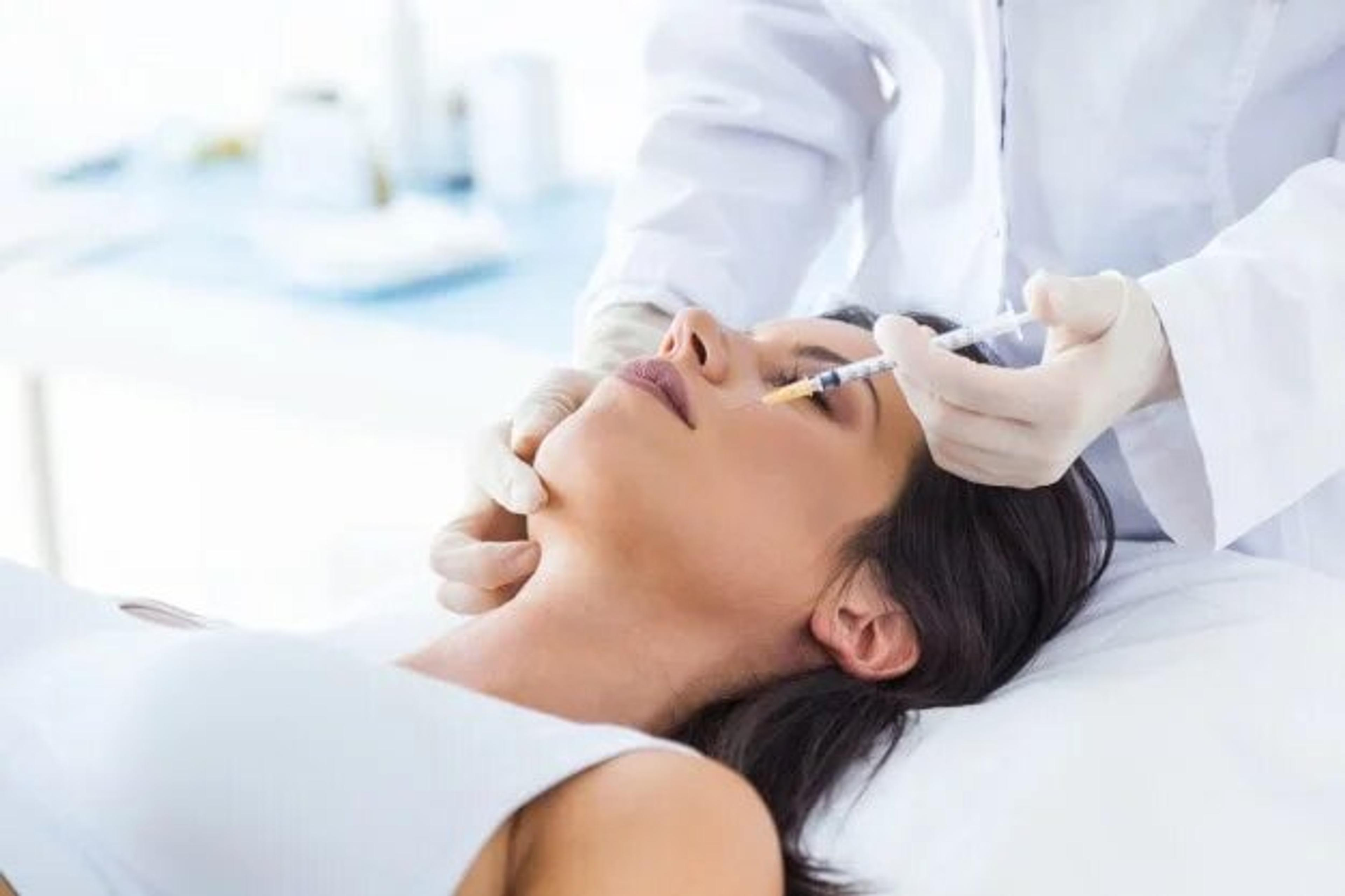 Patient receiving cosmetic injection treatment
