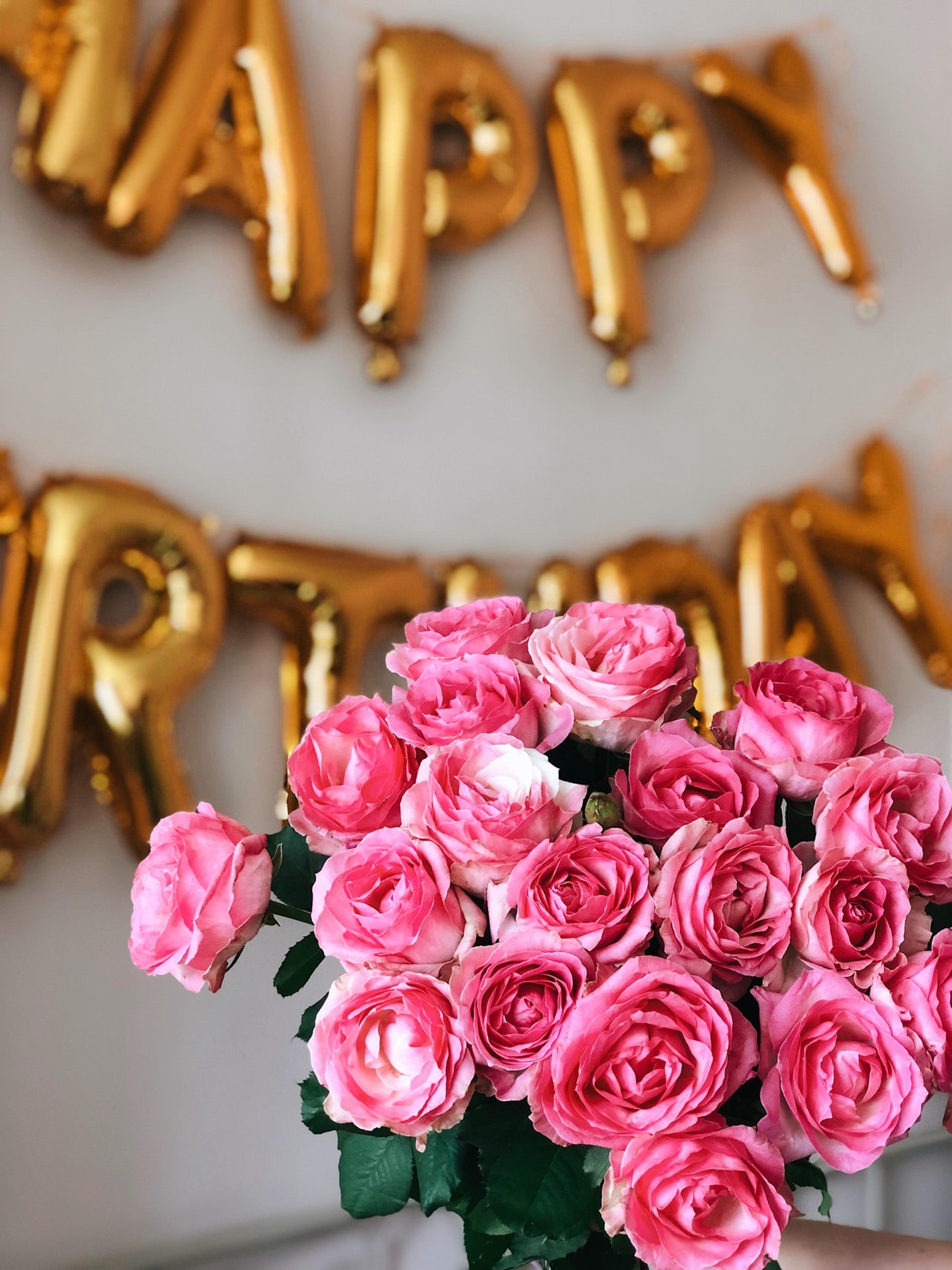 Flowers and Happy Birthday balloons