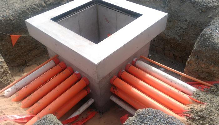 Electrical & Comms Conduits into concrete pit using bellmouths