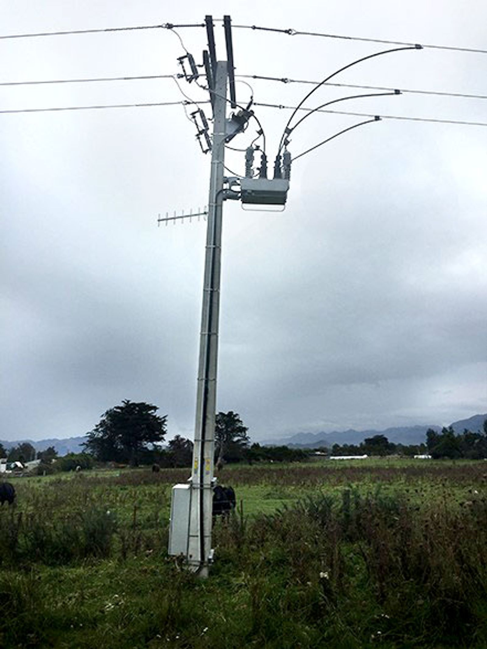 Copyright NOJA Power 2021, an OSM Recloser after the 2016 Kaikora Earthquake in New Zealand (note the sunken pole)