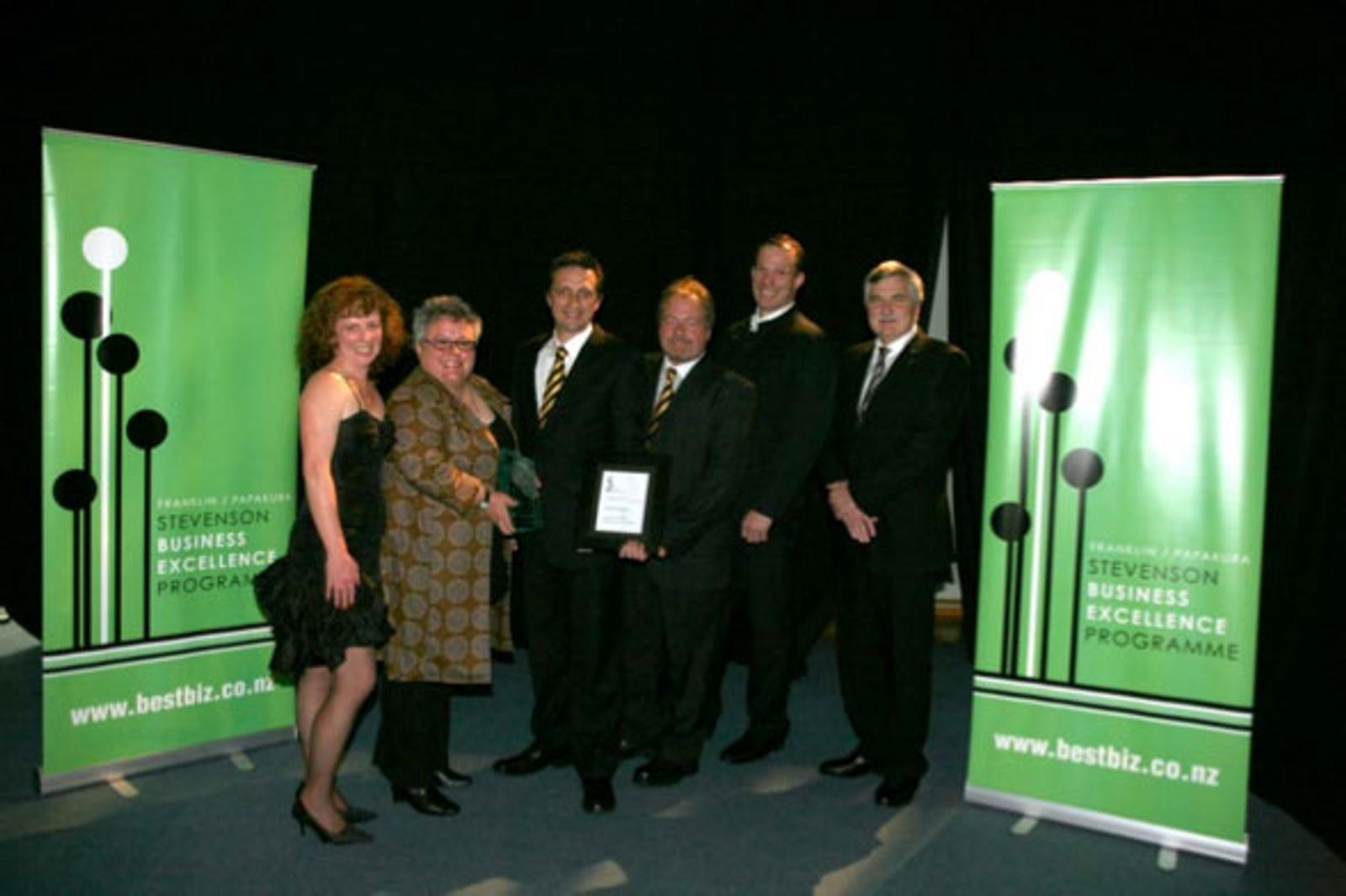 OHUG team, left to right: Michelle Rigby, Nan Russell, Steve Rigby, Tony Burtton, Tony Diment and Category Sponsor, Franklin Food's, Paul Brown show off the Best Emerging Business Award.