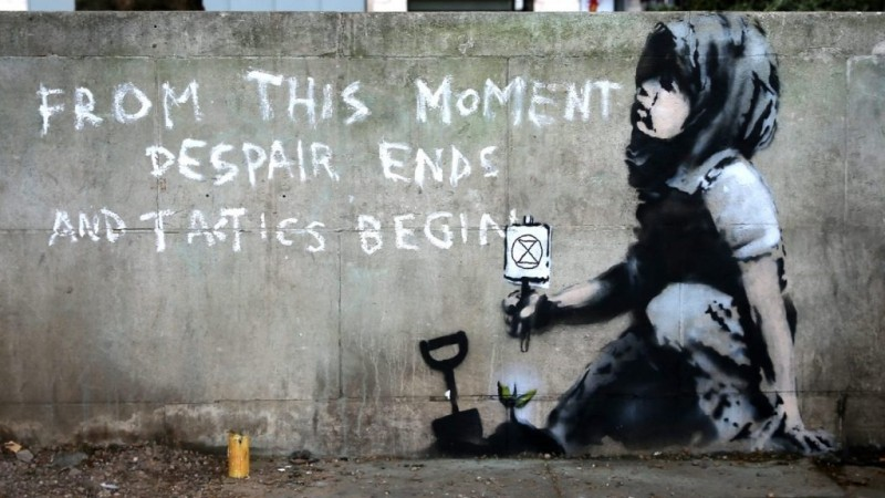 """From this moment despair ends and tactics begin."" newest Banksy's mural"