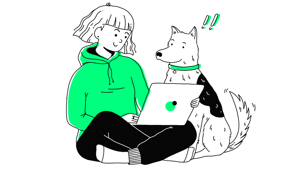 woman working remotely on laptop with dog