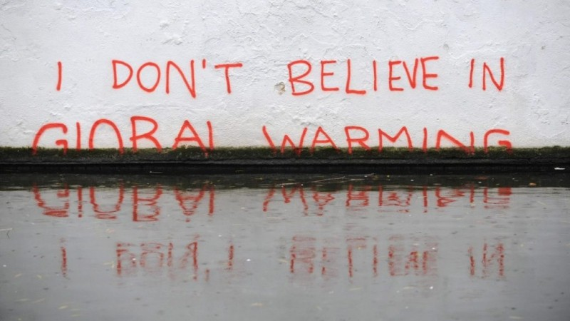 """I DON'T BELIEVE IN GLOBAL WARMING"" mural in north London to highlight rising sea levels"