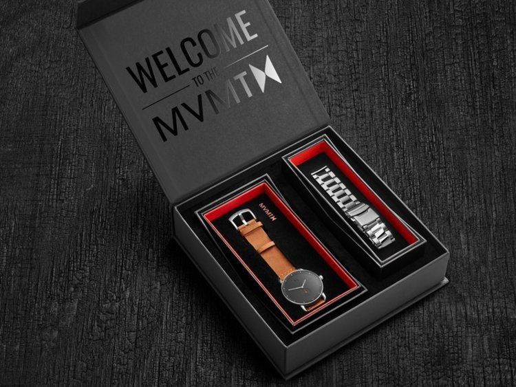 "Black Friday display ad of an Elegant MVMT timepiece box set inside finely textured background. Box reads ""Welcome to the MVMT."""