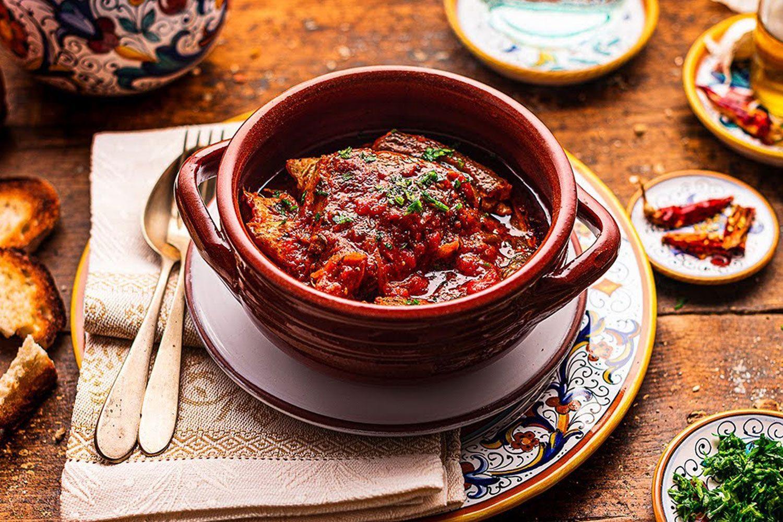 Tegamaccio (fish stew) on a bed of bread
