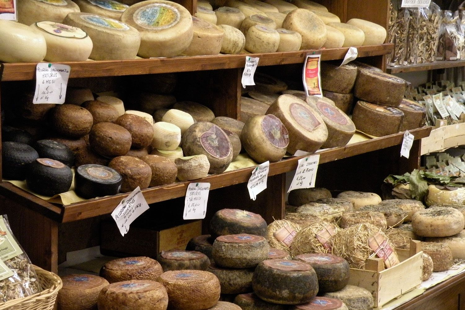 A selection of Pecorino cheeses on display in Pienza.
