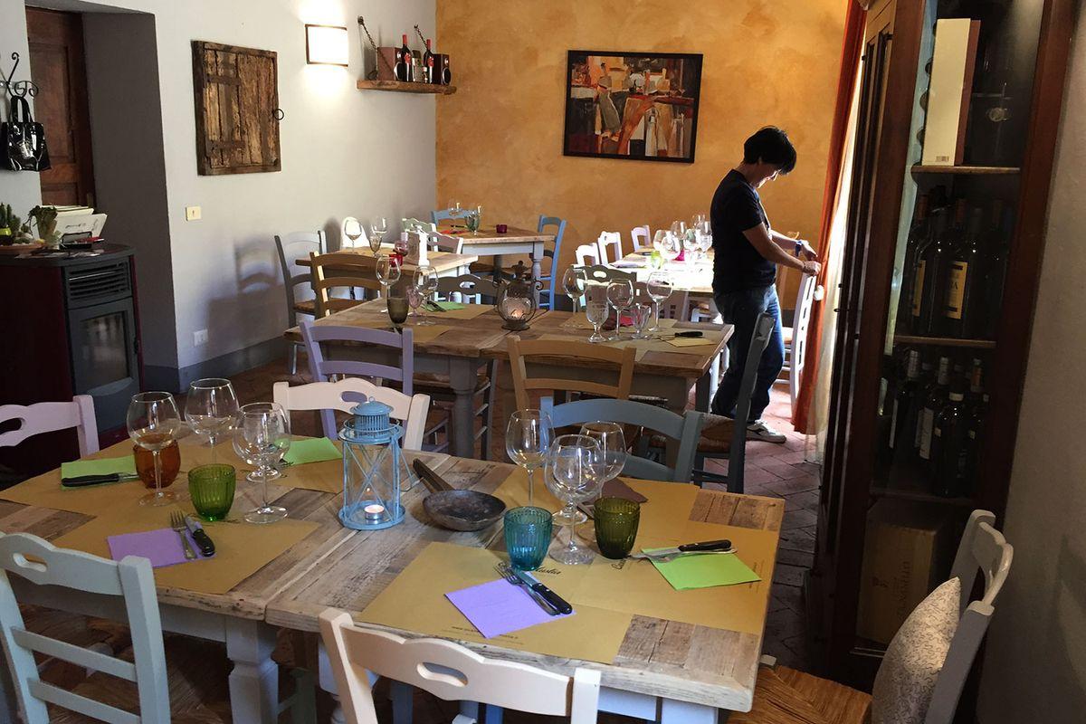 Paola preparing the dining room at Locanda di Casalmustia.