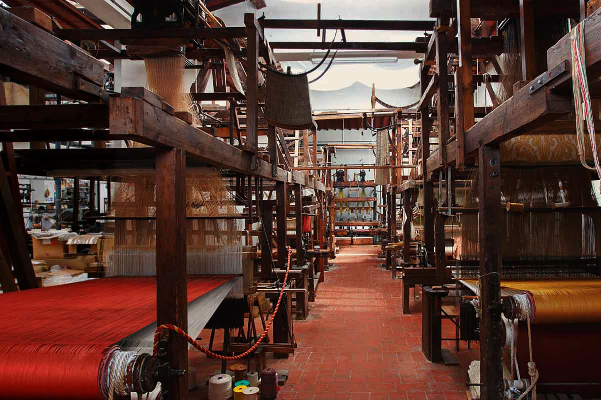 Ancient looms still producing excellent cloth in Florence.