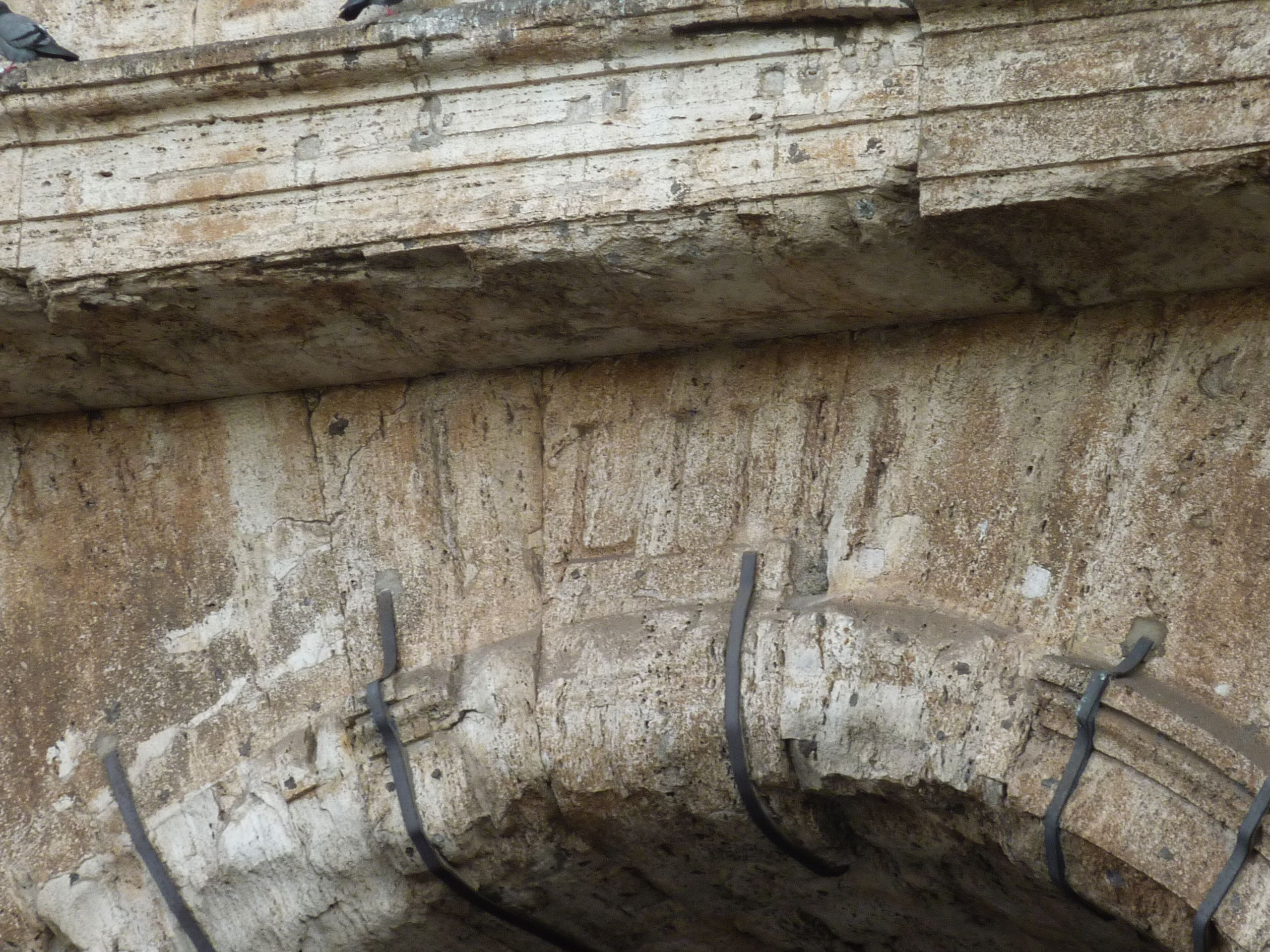 Entrance numbers carved in Roman numerals still seen on the Colosseum today.