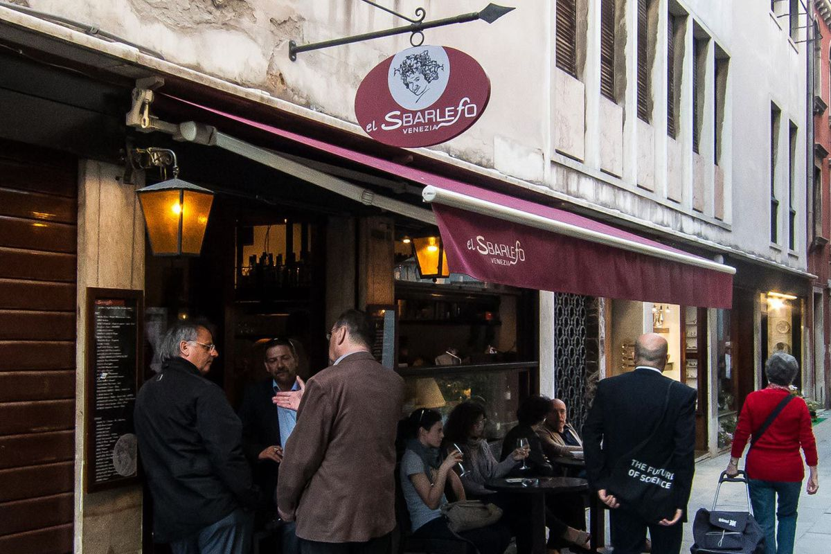 Catching up with friends at your local barcaro (wine bar) in Venice