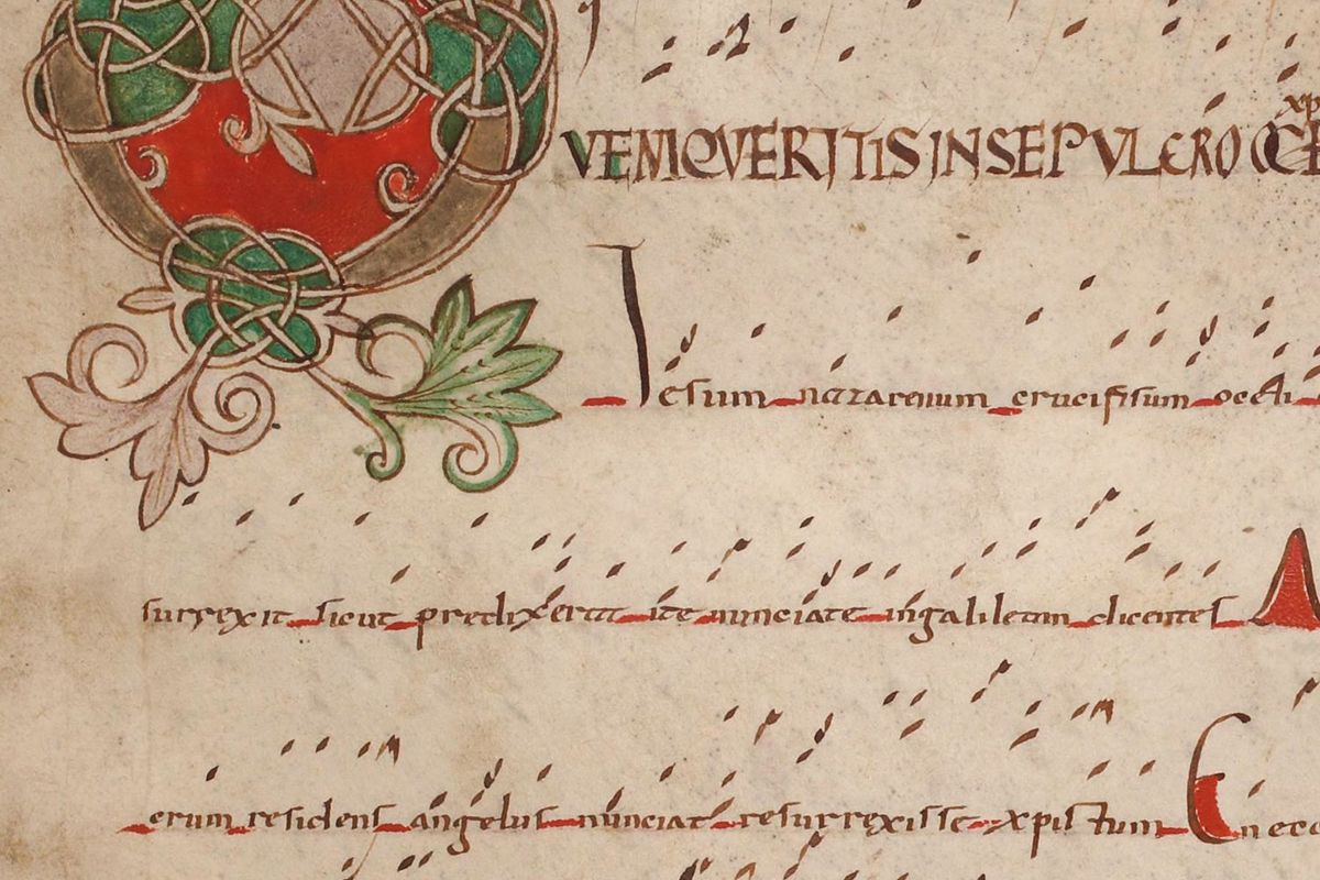"""A very early manuscript showing """"neumes"""" marked above the words to be sung."""