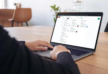 property manager on laptop looking at SmartRent platform
