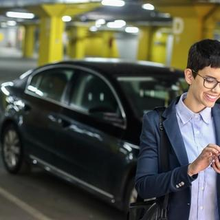 woman smiling at her phone inside parking garage