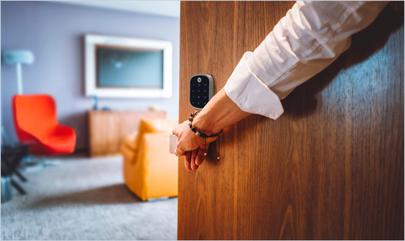 person opening door to aparment