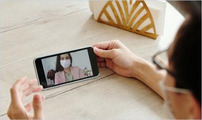 person on video call with face masks on