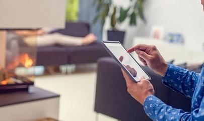 man using iPad in apartment
