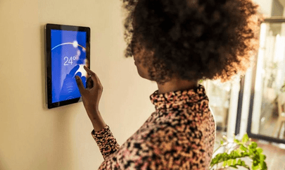 Image of woman using smart home device