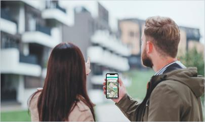 couple touring apartment community with SmartRent self-guided tours app on phone