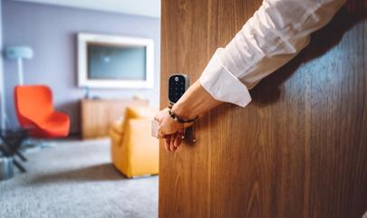 person entering a home with smart lock on the door