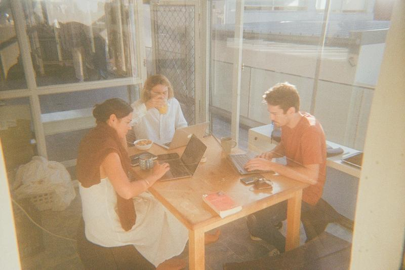 Xanthe (Books and Customer Managment), Hamish (Operations) & Darcy (Strategy) meeting over a morning coffee.
