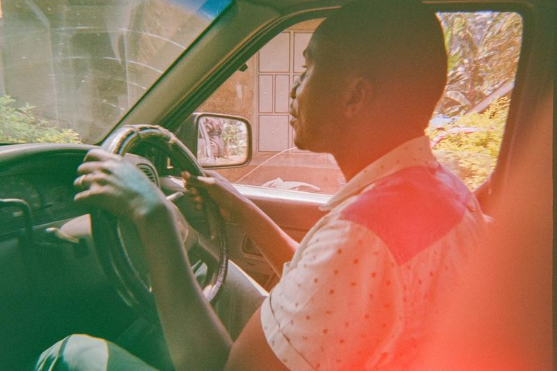 Issac navigating a car rough terrain on Mount Elgon, Uganda. World Positive Coffee.