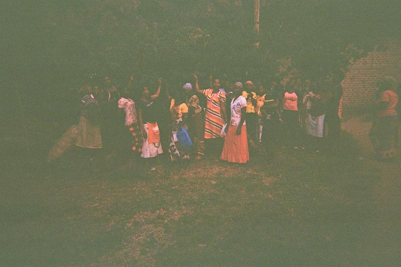 This is a group photo of Mayi Olive Lulaba together with the women in coffee plantation. These women get money from coffee and put it to saving in their village women save scheme.