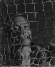 Male Portrait behind Fishing Net [PL7], c.1939