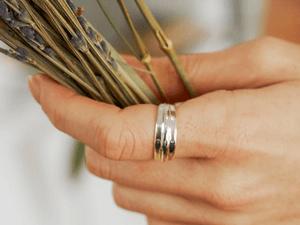 RIng on finger holding grass