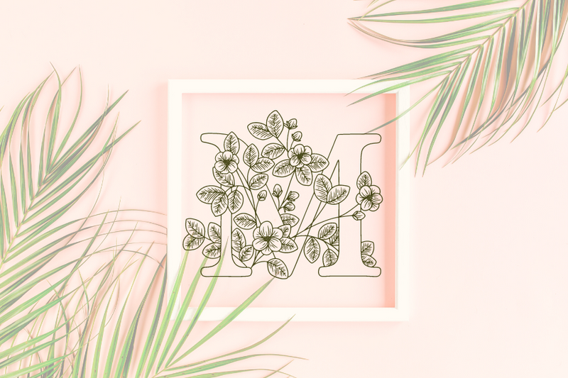 Letter M graphics with floral background