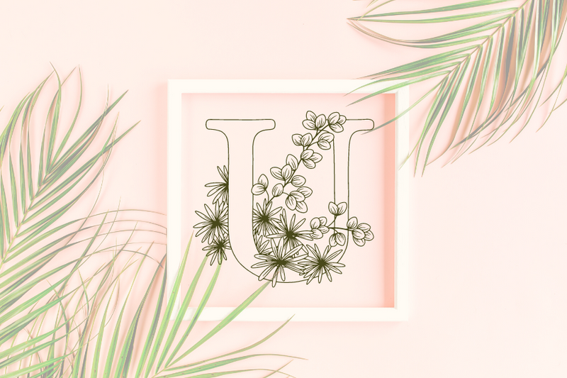Letter U graphics with floral background