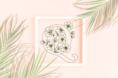 Letter Q graphics with floral background