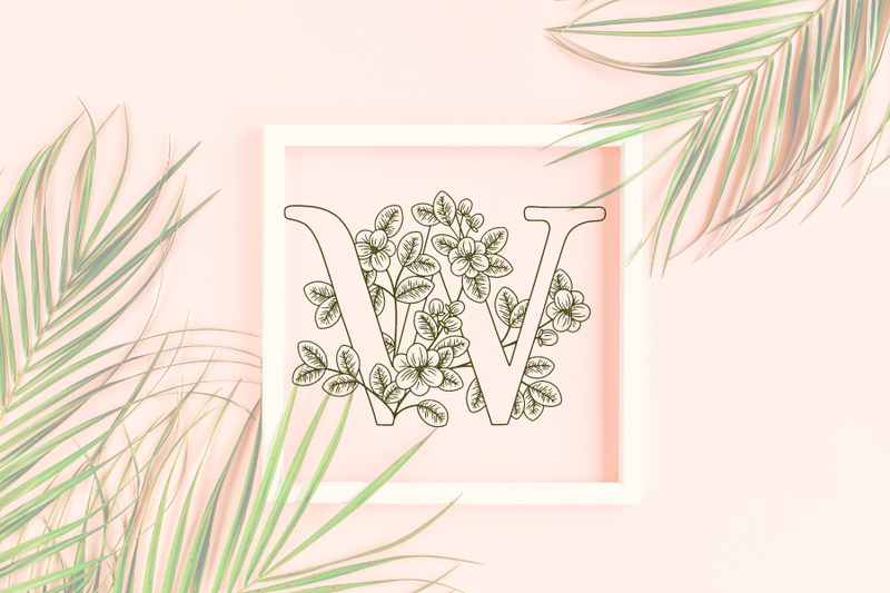 Letter W graphics with floral background
