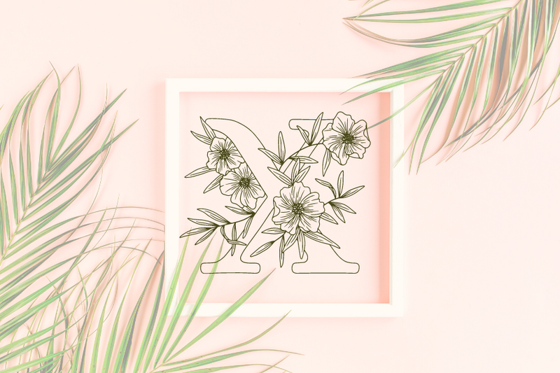Letter X graphics with floral background