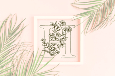 Letter H graphics with floral background