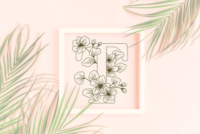 Letter T graphics with floral background
