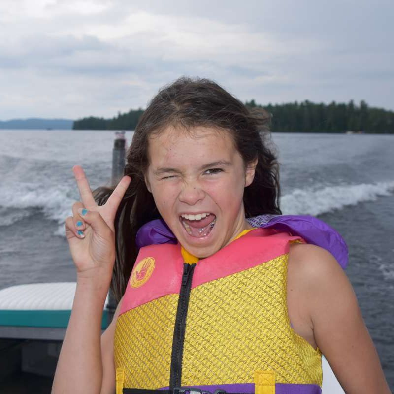 camper posing for a photo with the peace sign at Canadian Adventure Camp