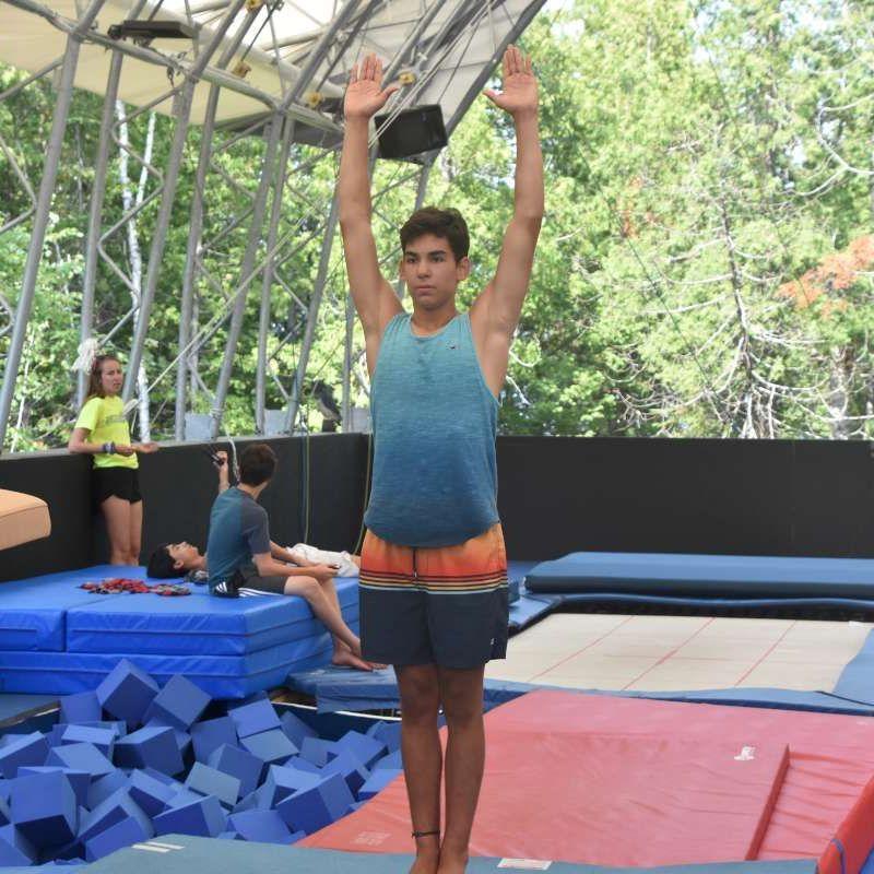 Boy camper training in the gymnastics program at Canadian Adventure Camp