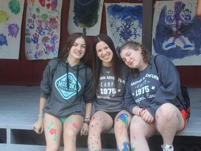 teenage campers with body paint smiling at the camera