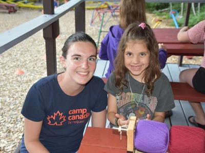 twinkie counsellor with young camper at Canadian Adventure Camp
