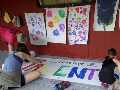 campers painting a giant poster together at Canadian Adventure Camp